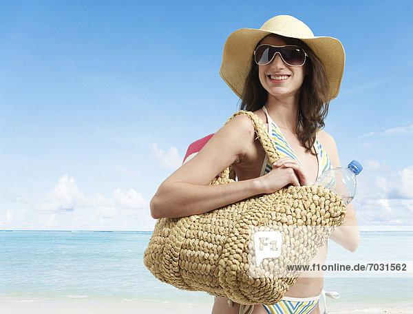 Young Woman in Beach Attire