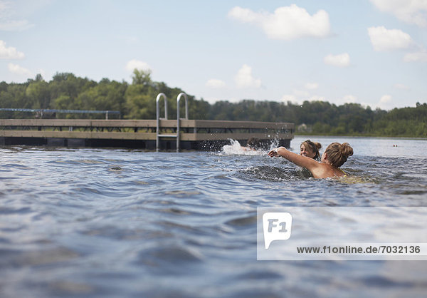 Three Teenagers Swimming