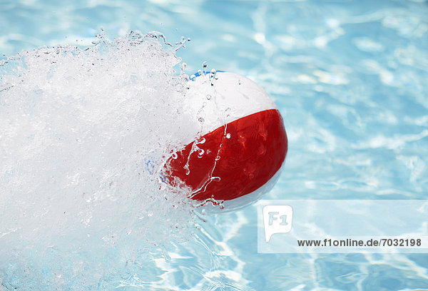 Beach Ball Splashing Water