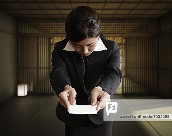 Businesswoman Giving Business Card