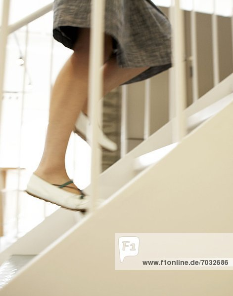 Close-Up of Woman Running Up Steps