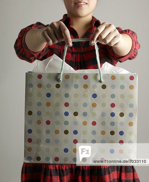 Mid-Adult Woman Holding Shopping Bag