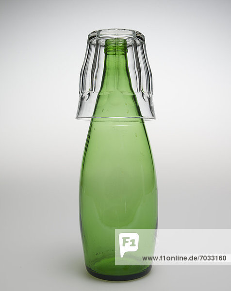 Glass Over Green Bottle