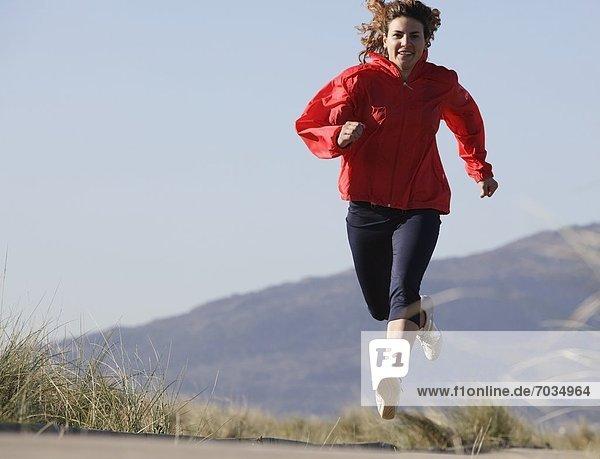 Frau  Strand  rennen  Athlet