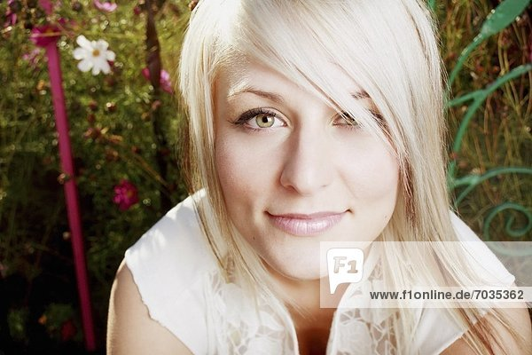 Portrait Of Young  Beautiful Blonde Woman Outdoors