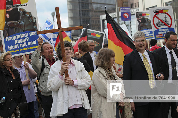 From rigth to left: Lars Seidensticker  federal whip and Manfred Rouhs  federal chairman of the Pro Germany Citizens' Movement  an anti-Muslim demonstration of the extreme right-wing party Pro Germany Citizens' Movement on Potsdamer Platz square  Berlin  Germany  Europe