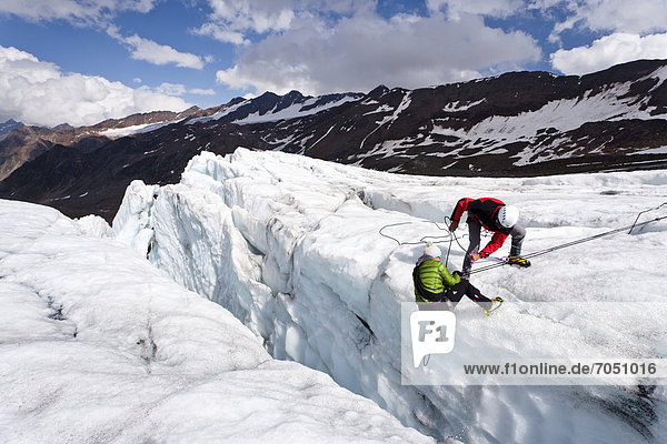Climbers performing a crevasse rescue Zufallferner Glacier in the Martell Valley above Marteller Huette hut  Alto Adige  Italy  Europe