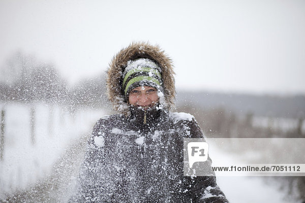 Young woman during a walk in the snow  Potsdam  Brandenburg  Germany  Europe