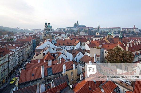 Prague Castle  St Nicholas Church  View from bridge tower of historic district  Prague  Czech Republic