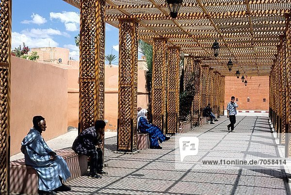 walkers under a pergola in the Mellah area  Marrakech  Atlas  Morocco  North Africa