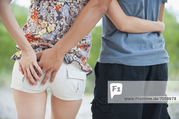 USA  Texas  Leakey   Young couple standing together with hand on hip