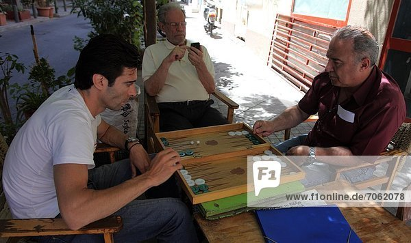 Mandatory Credit: Photo by Ros Drinkwater / Rex Features (1872701k) Game of Backgammon in a backstreet of Placa  Athens Greece - 2012