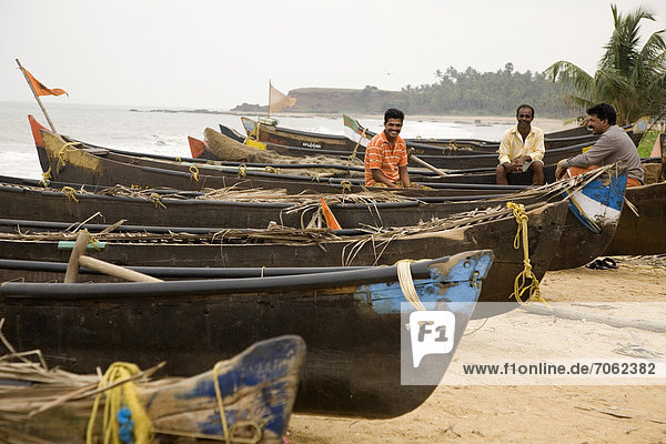 Mandatory Credit: Photo by Stuart Forster / Rex Features (1866033aa) Fishing boats pulled up on Kappil Beach in Kasaragod  Kerala India - 2012