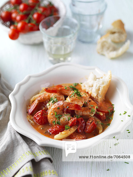 Mandatory Credit: Photo by Woman's Weekly / Rex Features (1805187g) Spanish style prawns  large prawns cooked in tomato  garlic  manzanilla sherry  WW 10/07/2012 Pub Orig Ripe Here  Ripe Now! These ten tantalising tomato recipes are bursting with sweet intense flavour. In fact  the dishes are so delicious you're sure to want to eat them all ripe here  ripe now. So why not rustle up these red delights  which all use the super fruit as the main ingredient. How about double tomato focaccia  Moroccan tomatoes or Spanish-style prawns. Then there's always roast fish supper  tomato and pepper galettes or a refreshing Bloody Mary sorbet. MUST CREDIT PHOTOS BY: Woman's Weekly / Rex Features *Please note: Rex has full rights to both the images and recipe words For more information visit http://www.rexfeatures.com/stacklink/ILFVKJJFU