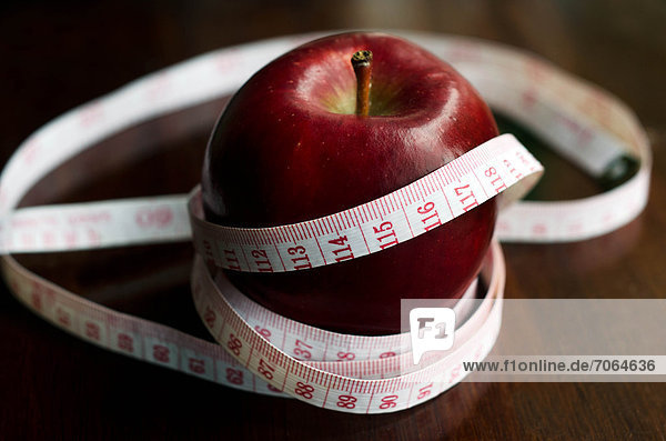Mandatory Credit: Photo by Chameleons Eye / Rex Features (1883740n) Measuring meter over a diet apple on kitchen table Various - 2012