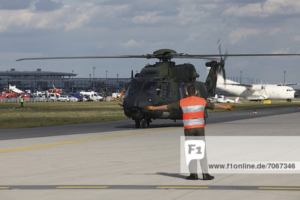 A German military helicopter landing  ILA Berlin Air Show  Berlin  Germany  Europe