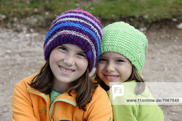 Two hiking girls wearing wool caps  province of Bolzano-Bozen  Alto Adige  Italy  Europe