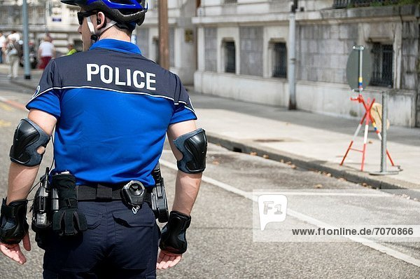 fully equipped policeman on the street of Geneva  Switzerland