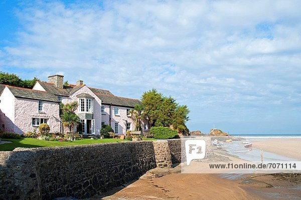 a charming pink cottage by the harbor at bude in cornwall  england  uk