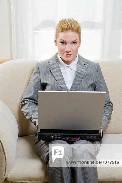 Woman working at home  using her laptop.