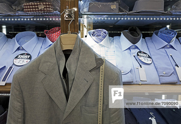 Display of men's shirts and a jacket in an Italian menswear store in Tallinn airport.