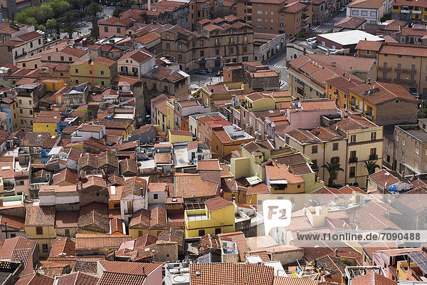 A view from above over the rooftops and historic buildings of the town of Bosa.