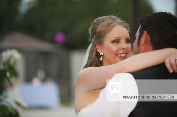 USA  Texas  Bride and groom romancing  close up