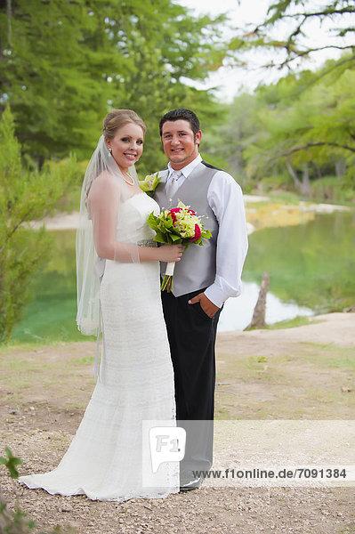 USA  Texas  Bride and groom smiling  portrait