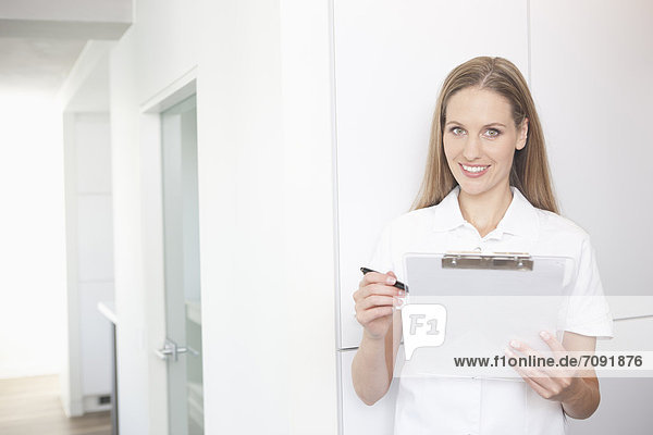 Germany  Dentist holding clip board