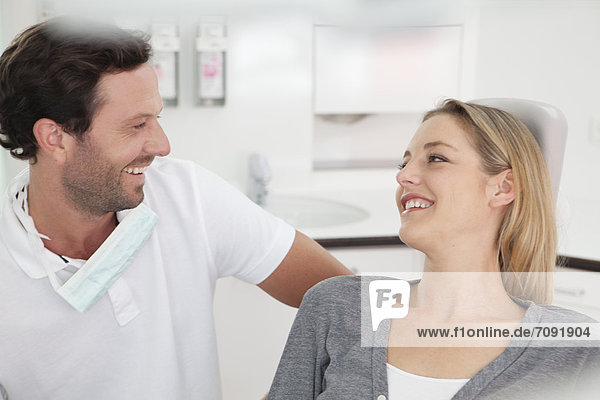Germany  Dentist and patient in clinic  smiling