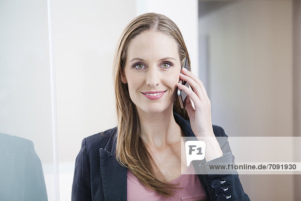 Germany  Young woman talking on phone