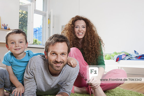 Germany  Berlin  Portrait of family  smiling