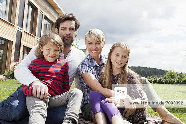 Germany  Bavaria  Nuremberg  Portrait of family in front of house