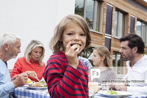 Germany  Bavaria  Nuremberg  Family barbecue in garden