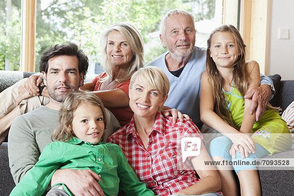 Germany  Bavaria  Numerberg  Portrait of family in living room
