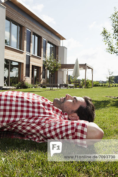 Mature man resting in garden