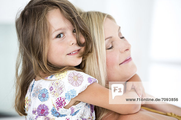 Germany,  Mother and daughter smiling,  close-up