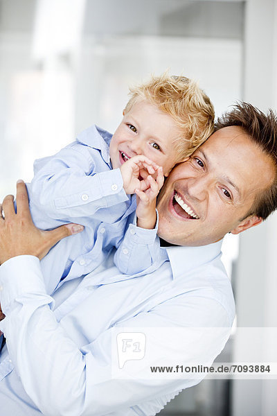 Germany  Father carrying son  smiling  portrait