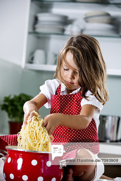 Germany  Girl playing with spaghetti