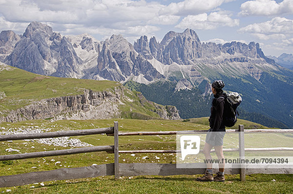 Italy  Mid adult woman looking at Schlern to Rosengarten at South Tyrol