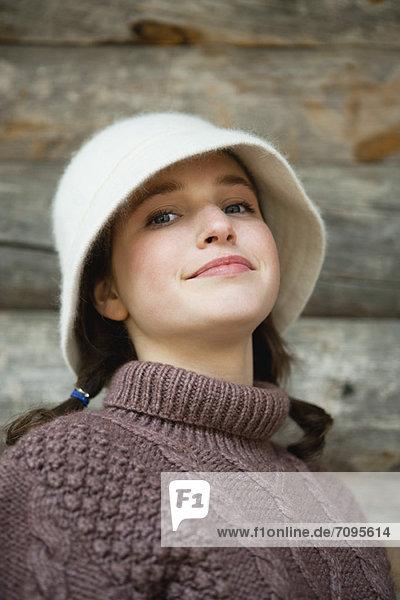 Teenage girl in turtleneck sweater  portrait
