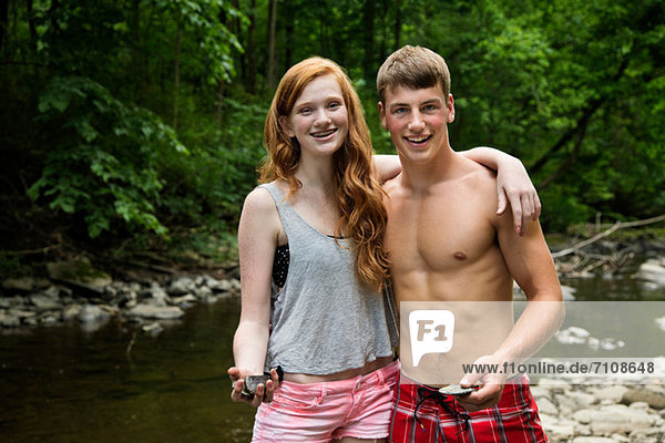 Couple standing by river  portrait