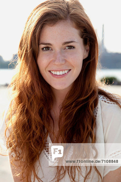 Young woman with long red hair  portrait