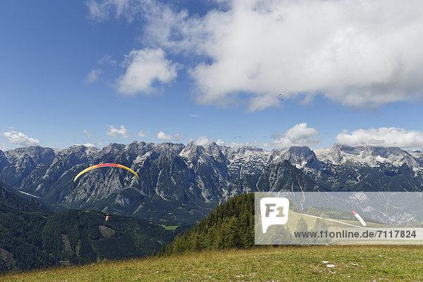 Paraglider taking off from Hutterer Hoess  Hinterstoder  Totes Gebirge mountains  Pyhrn-Priel  Traunviertel region  Upper Austria  Austria  Europe