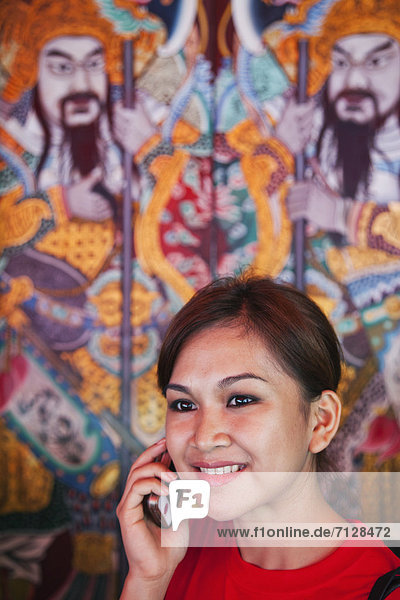 Asia  Singapore  Chinatown  Thian Hock Keng Temple  Temple  Temples  Chinese Temple  Chinese  Tourist  Asian Tourist  Female  Indonesian  Indonesian Woman  Phone  Mobile Phone  Communication  Tourism  Holiday  Vacation  Travel