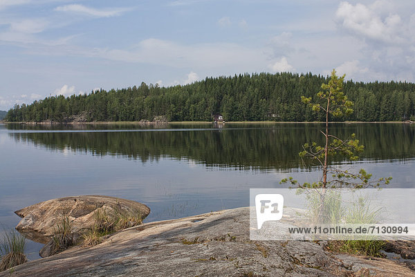 Scandinavia  Finland  north  Europe  Northern Europe  country  travel  vacation  lake  wood  forest  water  trees  reflect  island  reflection  rock  reflection