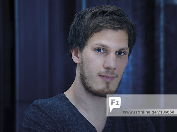 Portrait of a young man with a beard  looking serious  calm  relaxed