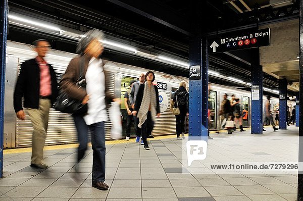 Commuters at 59th Street & Columbus Circle subway platform  Broadway  Manhattan  New York City  USA
