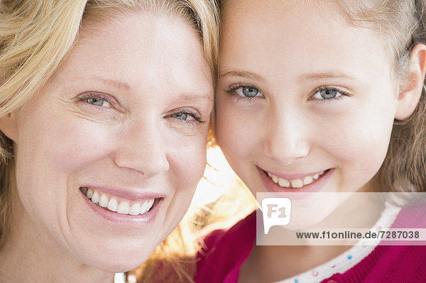 Portrait of smiling mother and daughter (8-9 years)