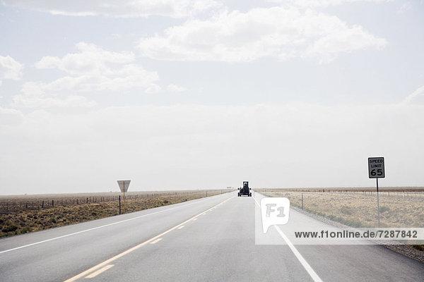 Car on open rural highway